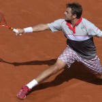 Switzerland's Stanislas Wawrinka returns the ball to Serbia's Novak Djokovic during their men's final match of the Roland Garros 2015 French Tennis Open in Paris on June 7, 2015.  AFP PHOTO / MIGUEL MEDINAMIGUEL MEDINA/AFP/Getty Images