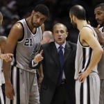 Spurs assistant coach Ettore Messina directs the team during a timeout against the Sacramento Kings at the AT&T Center on Friday, Nov. 28, 2014. Spurs defeat the Kings 112-104. (Kin Man Hui/San Antonio Express-News)