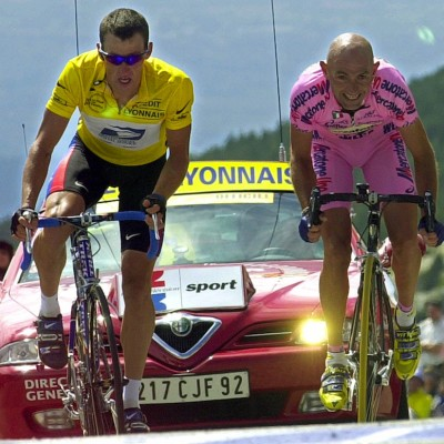 Marco Pantani, right, of Italy, sprints to beat overall leader Lance Armstrong, of Austin, Texas, and capture the 12th stage of the Tour de France cycling race between Carpentras and Mont Ventoux, southern France, Thursday, July 13, 2000. (AP Photo/Christophe Ena)
