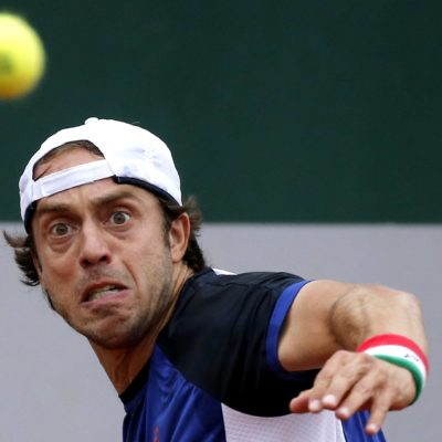 epa04769117 Paolo Lorenzi of Italy in action against Gilles Muller of Luxembourg during their first round match for the French Open tennis tournament at Roland Garros in Paris, France, 26 May 2015.  EPA/ETIENNE LAURENT
